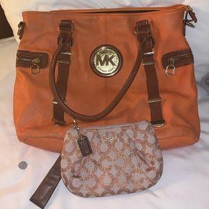 Michael Kors purse and Coach wristlet
